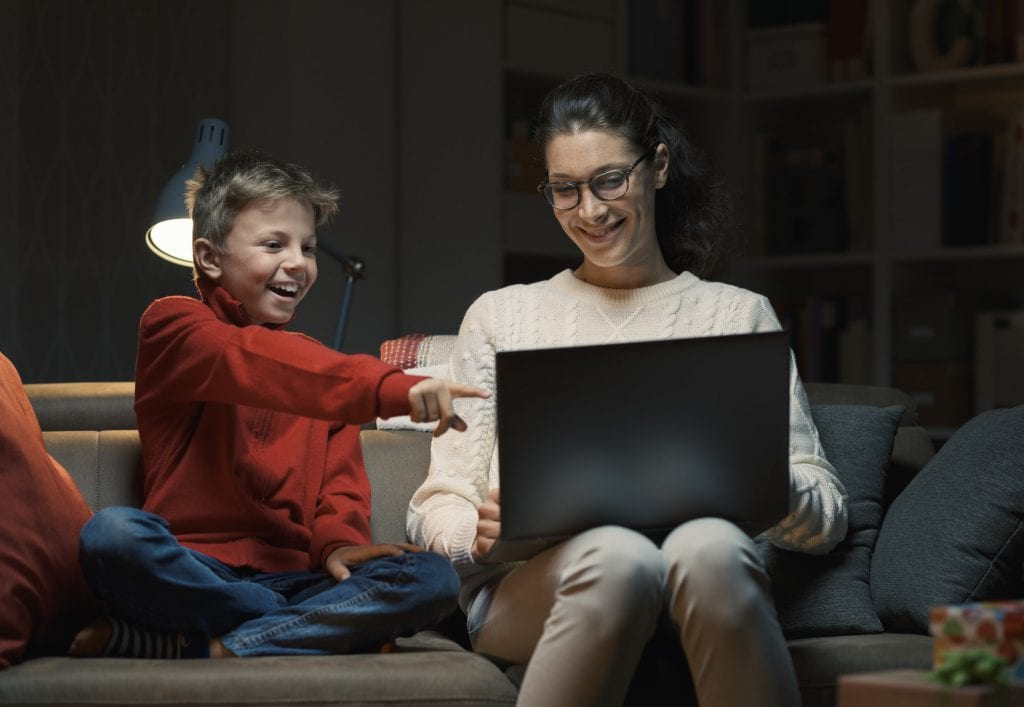 Mother and son watching movies on a laptop