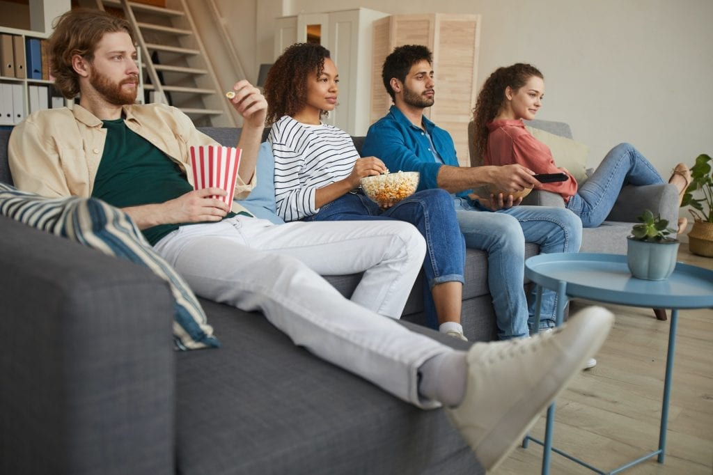 Multi Ethnic Group of Friends Watching Movies at Home